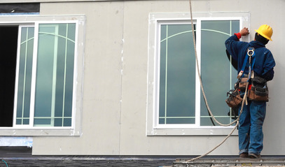 Contractor installing energy efficient windows