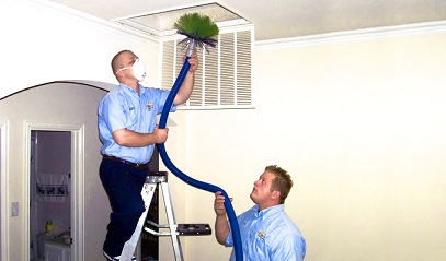Two contractors cleaning vents and ducts.