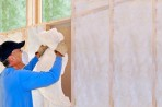 Contractor installing insulation