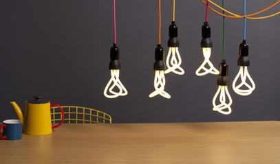 Energy efficient LED light bulbs hanging over table