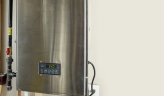 A tankless hot water heater with digital display.