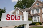 Sold sign on energy efficient house