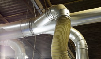 Picture of a flexible heating pipe, attached to a vent.
