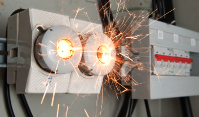 Sparks from a wire, setting off a short circuit