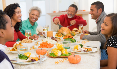 Family sitting at a table eating turkey