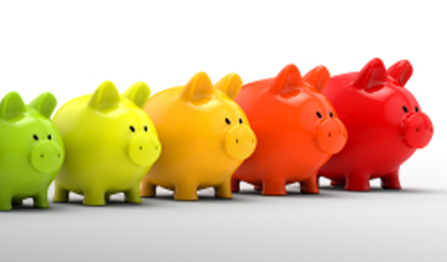 row of multi-colored piggy banks from small to large in size.