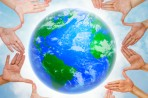 planet earth ringed by touching hands with outstretched fingers