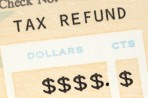 picture of tax refund check with dollar symbols