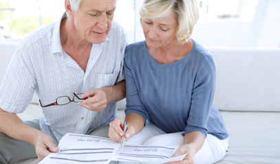 older couple looking at a report