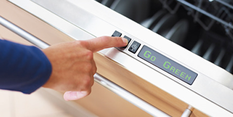 picture of hand setting dishwasher setting to eco